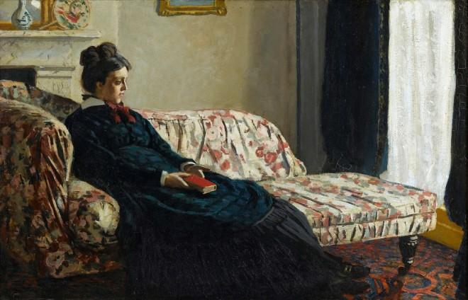 Madame Monet sitting on a sofa 1870